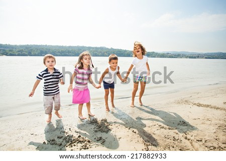 Kids are playing on the beach