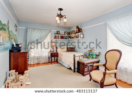 Kids bedroom interior in blue tones with cherry wooden furniture and nice curtains. Northwest, USA
