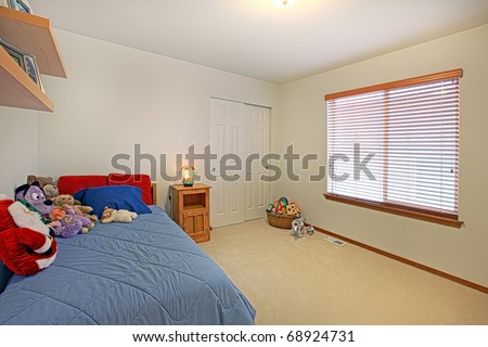 Kids bedroom with toys on the bed