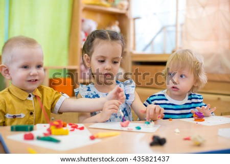 kids doing arts and crafts in day care kindergarten