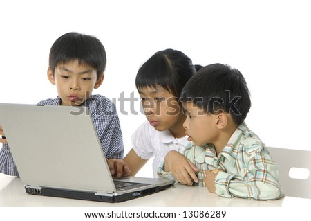 kids playing computer games or learning online