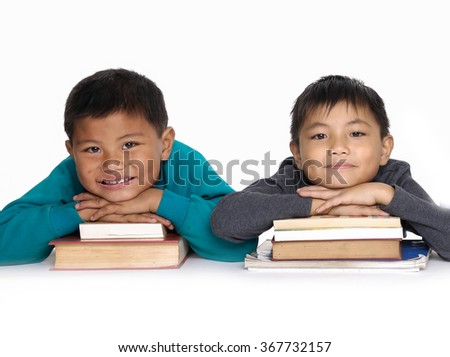 Kids sitting with book together