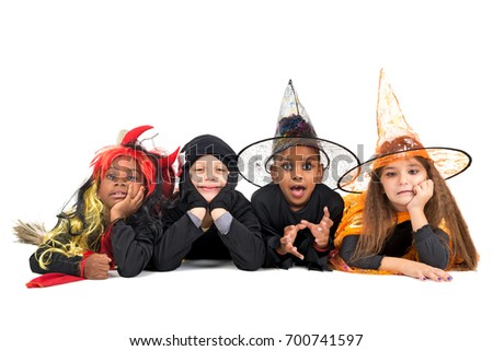 kids with facepaint and halloween costumes isolated in white