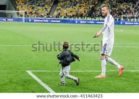 KIEV, UKRAINE - APRIL 24, 2016: Andriy Yarmolenko of Dynamo Kiev and his son celebrating a victory in the championship after the winning match Ukrainian Premier League against Vorskla Poltava