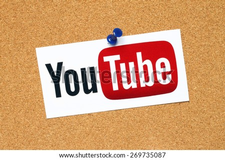KIEV, UKRAINE - APRIL 15, 2015: YouTube logotype printed on paper and pinned on cork bulletin board. YouTube is a video-sharing website