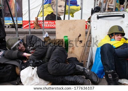 KIEV, UKRAINE - February 19, 2014: Mass anti-government protests in the center of Kiev. Protesters resting after an overnight battle on Independence Square