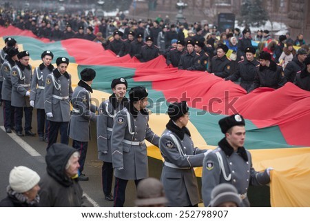 KIEV, UKRAINE - FEBRUARY, 15, 2015: Several thousand people marched with the 200-meter flags of Ukraine and Lithuania on Khreschatyk and Independence Square