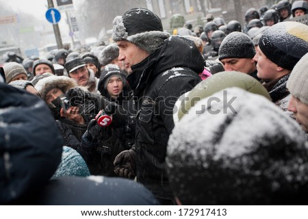 KIEV, UKRAINE  - JAN 21: Popular ukrainian opposition politician Vitali Klitschko gives interviews to journalists and the public in the crowd during anti-government protest on January 21 2013 in Kyiv