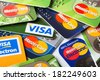 KIEV, UKRAINE - March 11: Pile of credit cards, Visa and MasterCard, credit, debit and electronic, in Kiev, Ukraine, on March 11, 2014. - stock photo