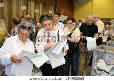 Kiev, Ukraine - May 25, 2014: Election of the President of Ukraine and Kiev measure. Voters study bulletins for voting.