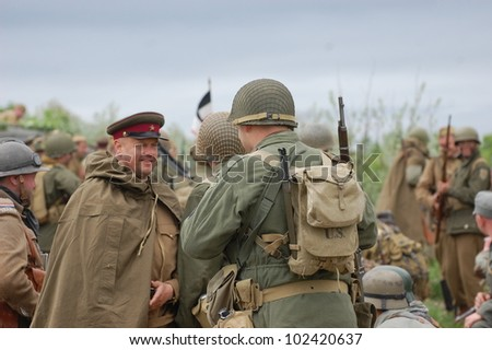 KIEV, UKRAINE -MAY 13: Members of Red Star history club wear historical German,Soviet and American  uniforms during historical reenactment of WWII, May 13, 2012 in Kiev, Ukraine