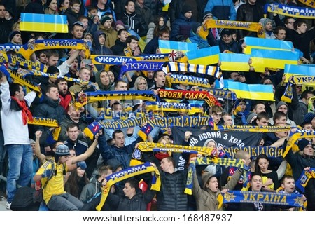 KIEV, UKRAINE - NOV 15: Fans of Ukraine with attributes during the play-off match for the 2014 World Cup between Ukraine vs France, 15 November 2013, NSC Olympic Stadium, Kiev, Ukraine