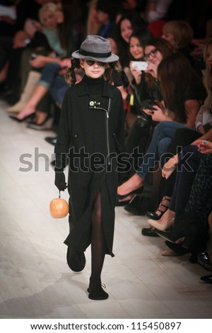 KIEV, UKRAINE - OCT 10: Children model run on the runway during