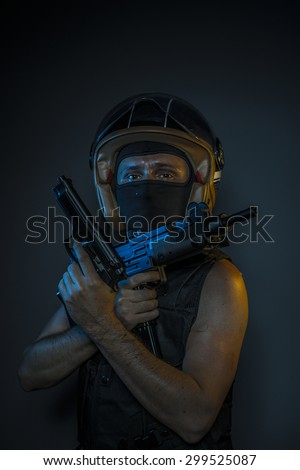 Killer, murderer with motorcycle helmet and guns