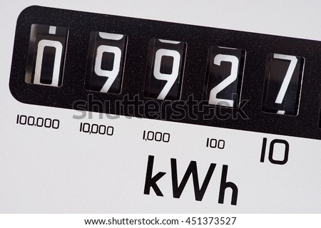 Kilowatt electric meter close-up and five digits.