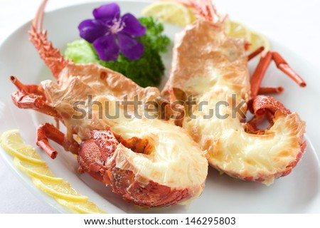 King prawn with cheese sauce served fine dining style