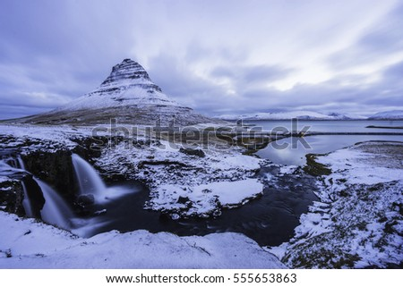 Kirkjufell mountain with water falls at winter, Iceland