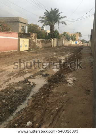 Kirkuk, Iraq - Dec18,2016: old alley in Iraq suffering after rain due to trash and mud situation which makes people hard to get outside their houses