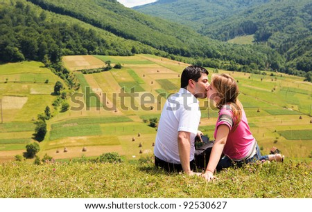 kissing couple in mountain Carpathians