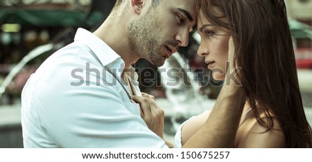 Kissing couple on the street