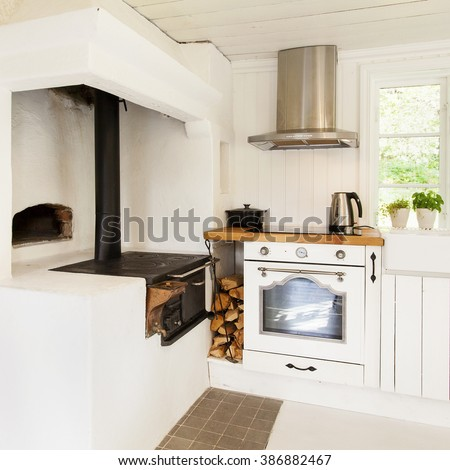 kitchen interior in a country-house with antique wood stove