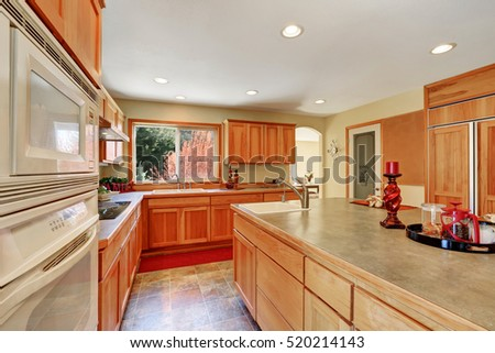 Kitchen Interior With Honey Cabinets , Built In Appliances And Large  Kitchen Island. Northwest