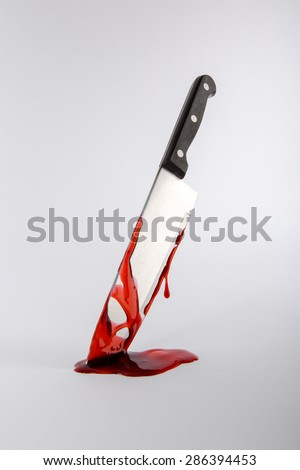 Kitchen knife dripping in blood