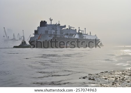 KLAIPEDA,LITHUANIA- FEB 28:GOLAR SEAL LNG Tanker in Klaipeda port  in very cloudy and foggy day on February 28,2015 in Klaipeda, Lithuania. GOLAR SEAL is LNG Tanker, registered in Marshall Islands.