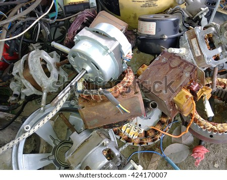 KLANG, MALAYSIA â?? MAY 21, 2016: Used components of table fan and other stuffs has disassembled for recycling purposes at junkyard or scrapyard.