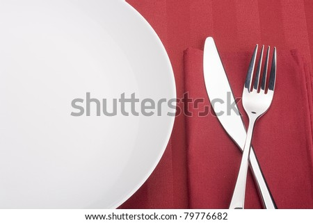 Knife and fork on a napkin as a dining room serving.
