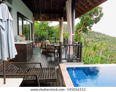 Balcony condo patio furniture plants stock photo 113811283 for Outdoor furniture samui