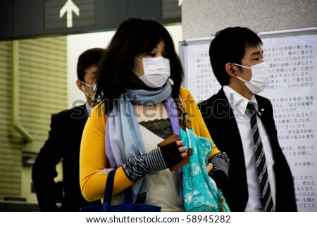 KOBE, JAPAN - MAY 20: People at the station wear face masks because of the outbreak of swine flu near Sannomiya JR station May 20, 2009 in Kobe, Japan.
