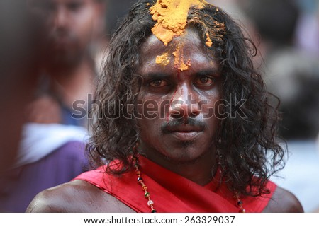 KODUNGALLUR, INDIA - MAR 20 : An unidentified oracle with forehead bruised by himself participates in the Bharani festival at Kodungallur Bhagavathi temple on March 20, 2015 in Kodungallur, India.