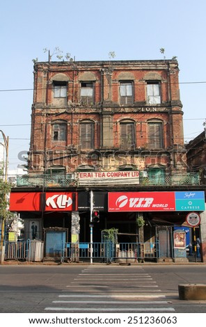 KOLKATA, INDIA - NOVEMBER 25: An aging, decaying, ex-colonial tenement block with shops in Kolkata, West Bengal, India on November 25, 2012.