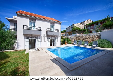 KOMIZA (VIS), CROATIA - AUG 15, 2015: - Traditional old Dalmatian house will charm you with its modern interior design made of stone and wood.