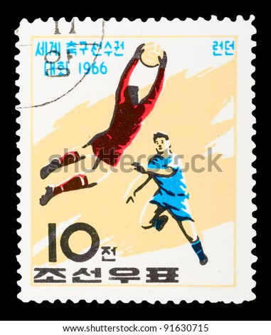 "KOREA - CIRCA 1966: A stamp printed in Korea Nord shows football boots, ball and cup with the inscription and name of a series ""Football World Cup, England, 1966â?�, circa 1966"