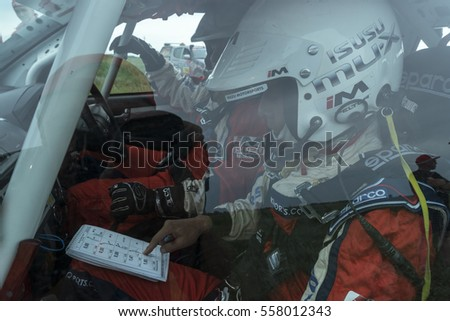 KOSTANAY, KAZAKHSTAN-JULY 12, 2016: Racing driver is preparing for the start of stage 4 during the Silk Way rally Moscow-Beijing Dakar series