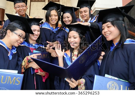 Kota Kinabalu, Sabah Malaysia. Nov 25, 2013 : Graduates from Universiti Malaysia Sabah (UMS) share their joy with friends during convocation.UMS is a leading public university in Sabah Borneo.
