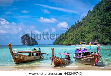 Krabi, Thailand - June 12th 2016 - Traditional boat anchored in a idyllic island in southern Thailand, close to Krabi.
