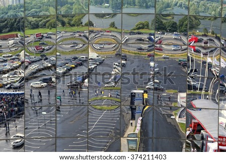 "Krasnogorsk, Russia - August 30, 2014: City reflection in the mirrored windows of ""Crocus City"" business center"