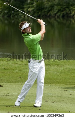 KUALA LUMPUR - APRIL 15: Jbe Kruger of South Africa hits shot in the 16th holes during final match of Maybank Malaysian Open 2012 at Kuala Lumpur Golf & Country Club on April 15, 2012