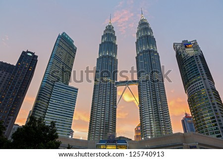 KUALA LUMPUR - AUG 29: view of The Petronas Towers at sunset on August 29, 2012 in Kuala Lumpur, Malaysia. 2 days before national day. Petronas are the tallest twin buildings in the world (451.9 m)