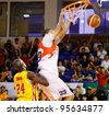 KUALA LUMPUR - FEBRUARY 19: Malaysian Dragons' Brian Williams (33) dunks against the Singapore Slingers at the ASEAN Basketball League match on Feb 19, 2012 in Kuala Lumpur. Dragons won 86-71. - stock photo