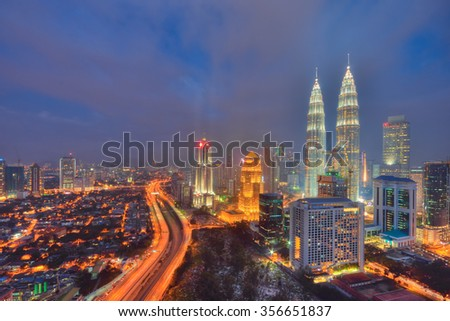 Kuala Lumpur, Malaysia - December 27, 2015. The KLCC Twin Towers during blue hour and it's reflection.