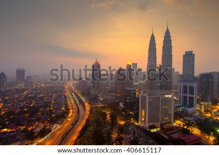KUALA LUMPUR, MALAYSIA - FEB28, 2016: Cloudscape view of the Petronas Twin Towers at KLCC City Center. The most popular tourist destination in Malaysian capital