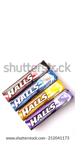 KUALA LUMPUR, MALAYSIA - FEBRUARY 11TH, 2015. Halls is the brand name of a popular mentholated cough drop and sold by the Cadbury-Adams Division of Cadbury, now owned by Mondel?z International.