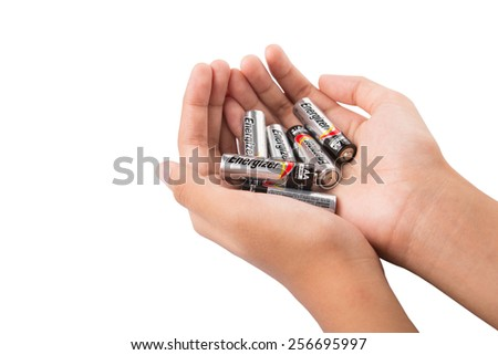 KUALA LUMPUR, MALAYSIA - FEBRUARY 27TH 2015. Hand holding used Energizer AA batteries. Energizer Holdings is an American manufacturer of batteries and are sold in over 165 countries worldwide.