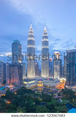 Kuala Lumpur, Malaysia - November 12, 2016: The golden sunset view of Petronas Twin Towers during blue hour in Kuala Lumpur.