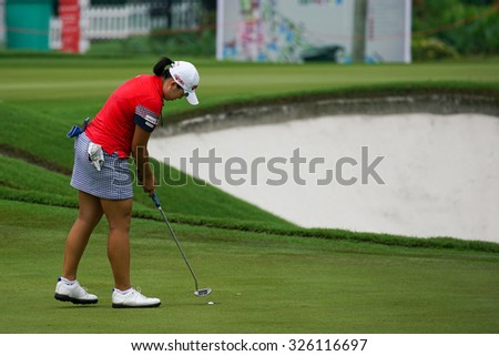 KUALA LUMPUR, MALAYSIA - OCTOBER 09, 2015: South Korea's Ha Na Jang finishes her putt at the 18th hole green at the KL Golf & Country Club at the 2015 Sime Darby LPGA Malaysia golf tournament.