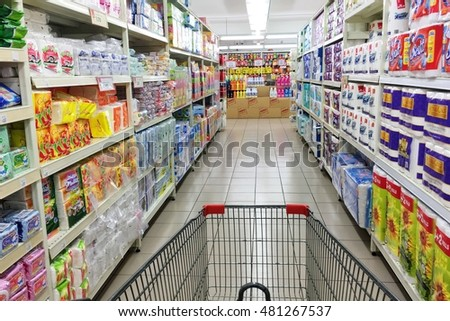 grocery cart supermarket aisle filled food stock photo